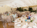 Wedding Marquee with white paper lanterns and ghost chairs