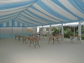 Pleated sky blue and white linings, transparent walls & cream carpet during setup period