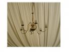 Brass chandelier against