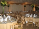 Gold swags with pleated ivory linings.