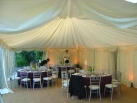 Fairy lights in front of ivory pleated linings